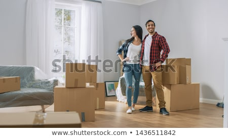 A couple posing with packed belongings Stock photo © IS2