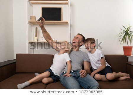 Father filming sons on camera Stock photo © IS2