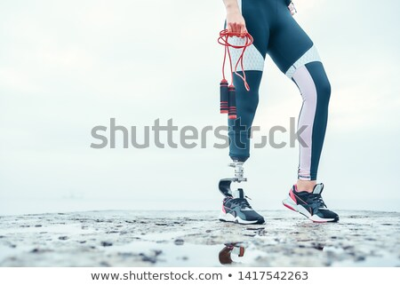 Image of beautiful invalid woman with prosthesis in tracksuit, s Stock photo © deandrobot