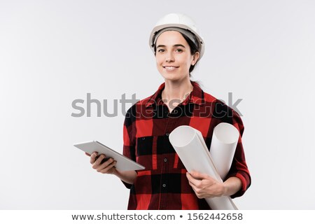 Happy young female architect in hardhat and flannel working over new project Stock photo © pressmaster