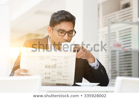 Young Business Man Is Reading Newspaper Outdoor Foto d'archivio © szefei