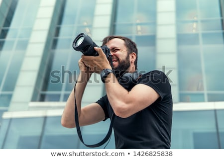 young handsome photographer stock photo © blanaru