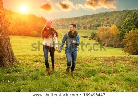 młoda · kobieta · romantyczny · jesienią · dekoracje · drzewo · drewna - zdjęcia stock © konradbak