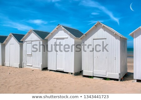 Blue and white beach cabins Stock photo © Hofmeester
