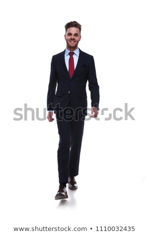 smiling businessman wearing a navy suit andred tie stepping Stock photo © feedough