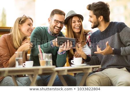 casal · digital · comprimido · restaurante · romântico · internet - foto stock © kzenon