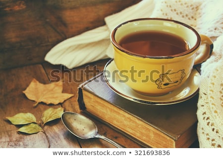 A cup of coffee on the background of an old wooden table A heart for coffee. St. Valentine's Day con Stock photo © galitskaya