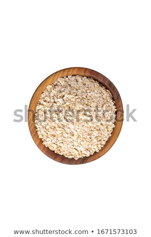 Healthy Organic Quick Oat Flakes in a Wooden Bowl Stock photo © StephanieFrey
