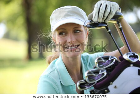 Girl golf player on golf course. stock photo © lichtmeister