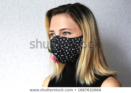 Stijlvol jonge vrouw zwarte gezicht masker Stockfoto © Giulio_Fornasar