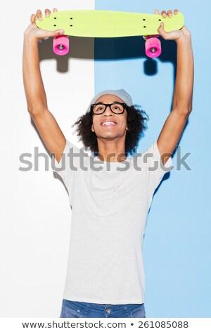 Сток-фото: Young Man With Skateboard Studio Shot Over White