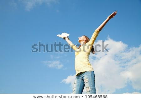 mulher · jovem · as · mãos · levantadas · blue · sky · céu · mãos · livro - foto stock © andreykr