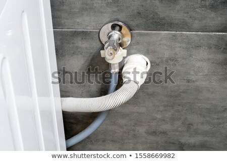 Plumber installing plastic domestic water pipes Stock photo © photography33