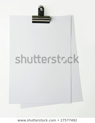 plain a4 paper and bulldog clip stock photo © shutswis