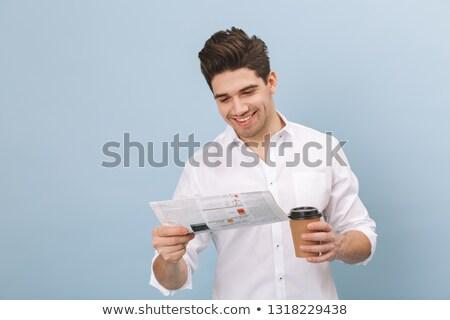 Portrait of a exited businessman reading a newspaper stock photo © wavebreak_media