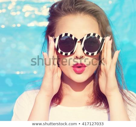 portret · mooie · jonge · vrouw · vergadering · ligstoel · buitenshuis - stockfoto © acidgrey
