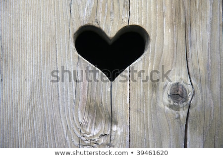 old wooden door with a carved romantic heart Stock photo © meinzahn