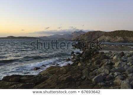 Waves breaking on a rocky shoreline Stock photo © jrstock
