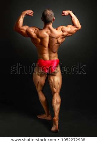 muscular bodybuilder showing his back double biceps stock photo © jasminko