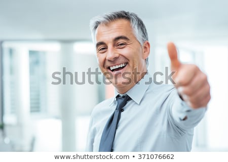 business man thumbs up stock photo © hasloo