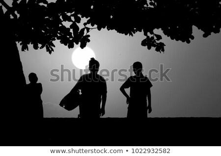 Gyönyörű naplemente kettő indonéz helyi nők Stock fotó © meinzahn