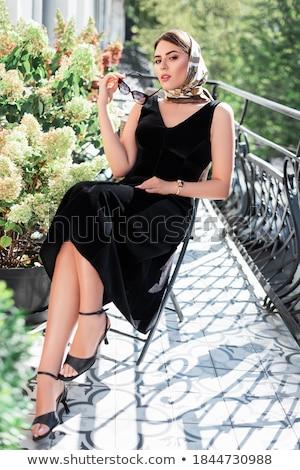 érzéki · barna · hajú · fekete · ruha · néz · kamera · közelkép - stock fotó © lithian