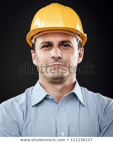 Successful architect in yellow hard-hat Stock photo © stockyimages