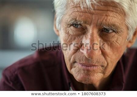Starszy człowiek patrząc zmartwiony stary depresji Zdjęcia stock © bmonteny
