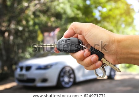 Car key - man locking pressing car keys on new car Stock photo © Maridav