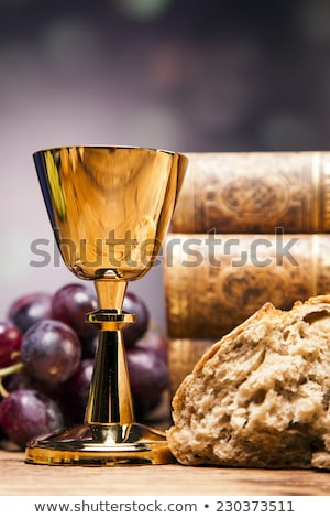 Sacred objects, bible, bread and wine. Stock photo © BrunoWeltmann