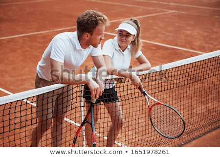 woman resting at tennis court stock photo © deandrobot