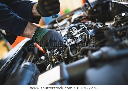 auto mechanic with tire wrench in garage stock photo © kurhan