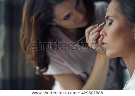 the woman does make up stock photo © oleksandro