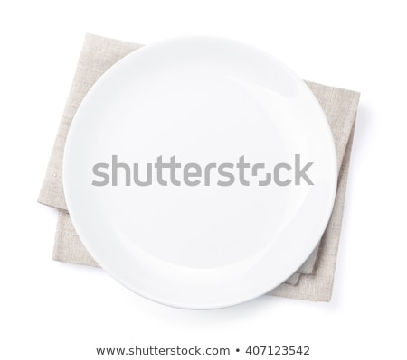 Empty plate over kitchen towel Stock photo © karandaev