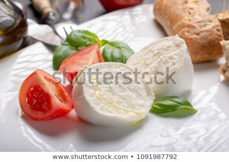 Tomato with buffalo mozzarella Stock photo © Digifoodstock