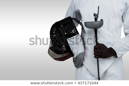 Composite image of mid-section of man standing with fencing mask Stock photo © wavebreak_media