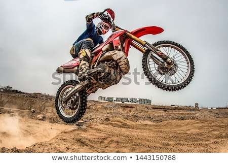 Motorcyclist and his motorcycle Stock photo © bezikus