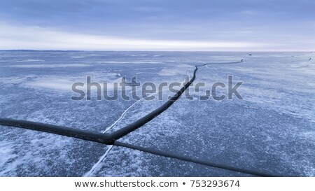 Ice-crack or ice break in a frozen lake stock photo © szabiphotography