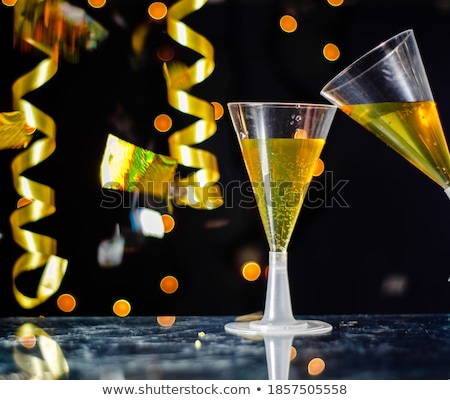 streamers in a glass of martini stock photo © imaster
