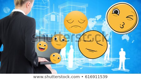 Young woman using laptop while emojis flying over Stock photo © wavebreak_media