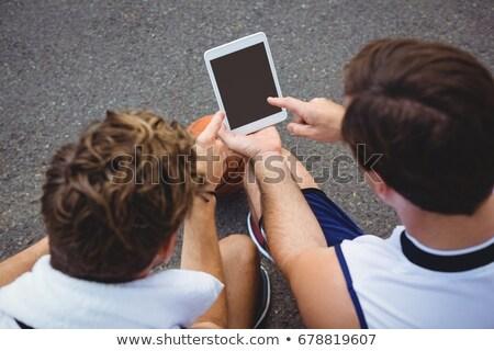 Overhead view of basketball players using technologies Stock photo © wavebreak_media