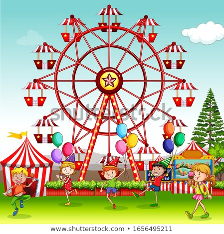 Happy children playing in park with ferris wheel in background Stock photo © bluering