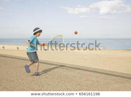 Boy playing tennis on promenade Stock photo © IS2