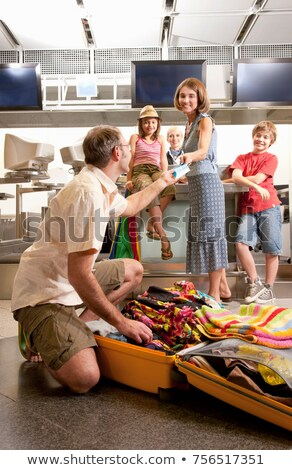 father handing over travel vouchers stock photo © is2