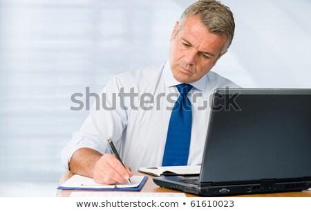 senior · imprenditore · lavoro · desk · ufficio · business - foto d'archivio © Minervastock