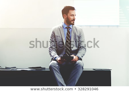 Stock photo: Portrait of entrepreneur man dressed in formal suit sitting outs