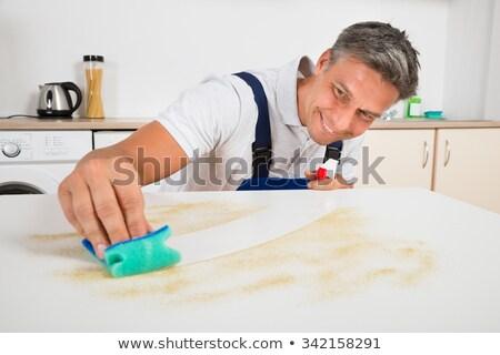 Mosolyog férfi gondnok takarítás konyhapult boldog Stock fotó © AndreyPopov