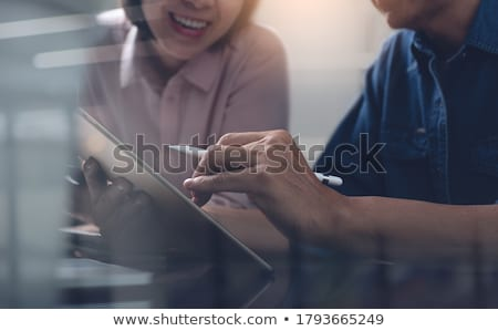 Smiling young business woman using computer  stock photo © Massonforstock