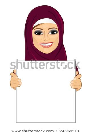 Arab woman holding sign or banner isolated on white background v Stock photo © NikoDzhi