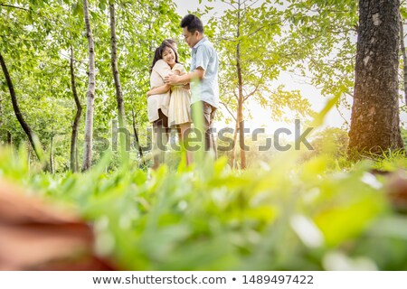 happy women or teenage girls hugging outdoors Stock photo © dolgachov
